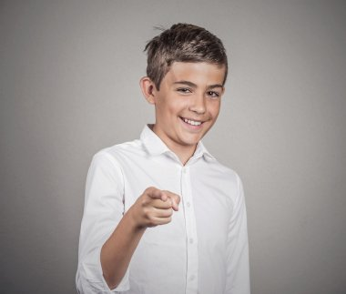 Teenager laughing, pointing with finger at someone