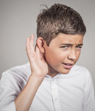 Hard of hearing man placing hand on ear asking to speak up