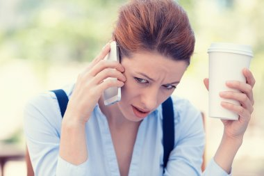 Upset sad, skeptical, unhappy, serious woman talking on phone