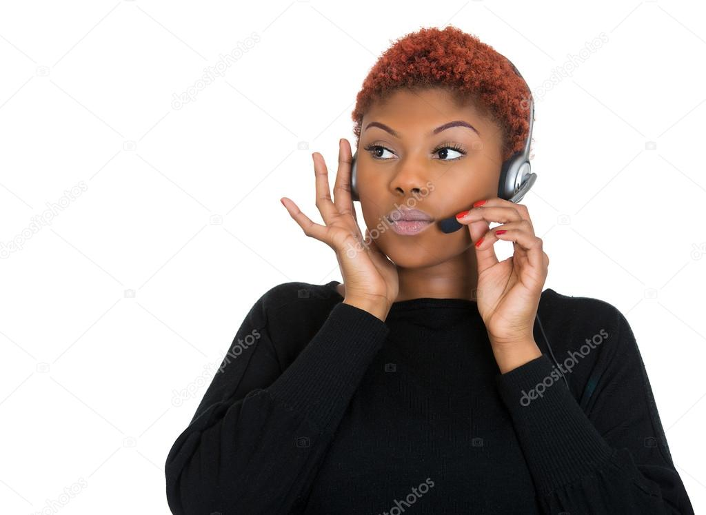Serious female customer service representative on a phone