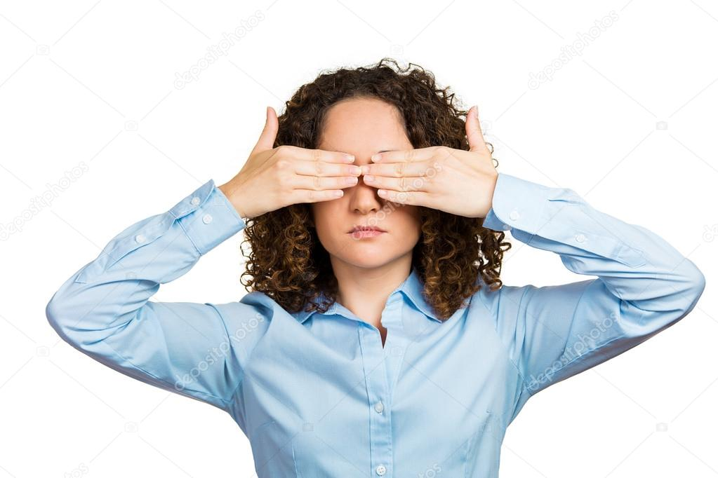 Woman covering eyes with hands can't look, hiding, avoiding situation