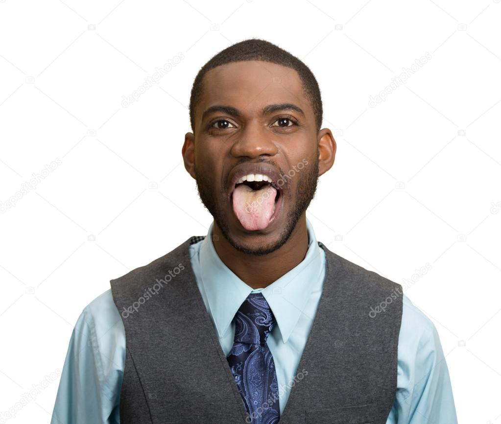 Man, employee sticking out his tongue
