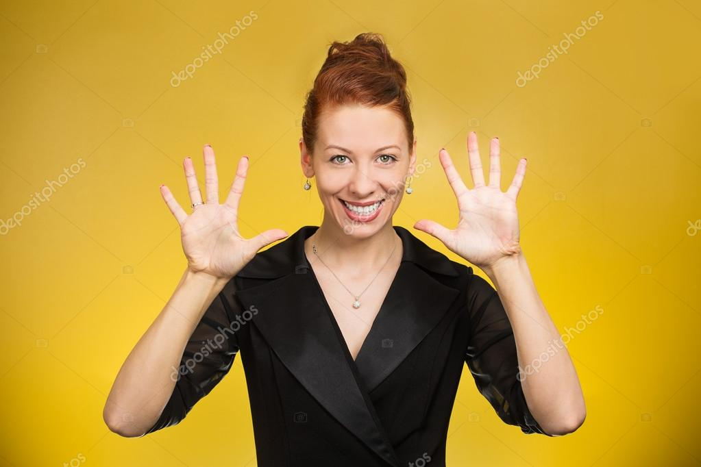 Woman making, showing five times sign gesture with two hands