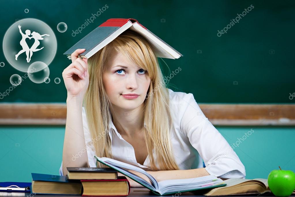 Daydreaming student, female teacher