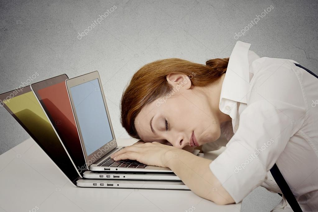 Sleeping woman at her desk, on computer