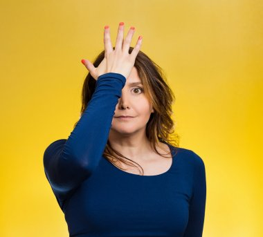 Woman realizes mistake, slapping hand on head to say duh,