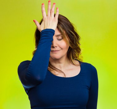 Woman realizes mistake, regrets, slapping hand on head to say duh