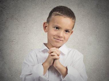 Boy gesturing with clasped hands, pretty please with sugar on top