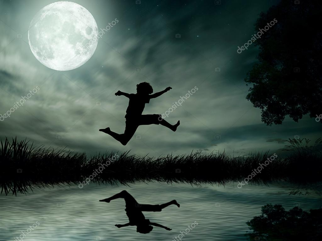 Teenager jumping in water, over lake with moonlight, moon background