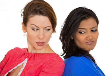 Closeup portrait two unhappy, angry girls, back to back, sad disappointed hate each other isolated white background. Negative human emotion facial expression, feeling, body language conflict situation stock vector