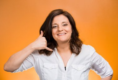 Woman showing call me gesture