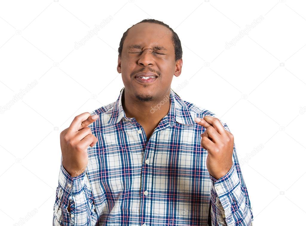 Business man crossing fingers