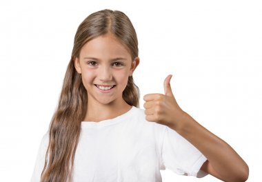 Happy teenager girl showing thumbs up sign