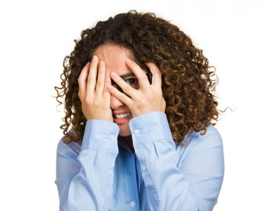 Woman shy, flirting, hands covering entire face