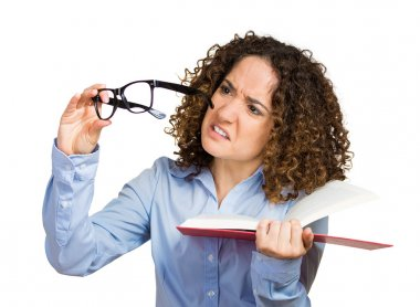 Young lady, woman can't see read book, has vision problems