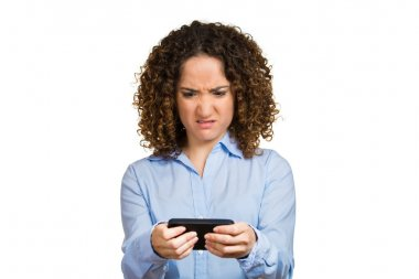 Woman unhappy, annoyed by someone on her cell phone while texting