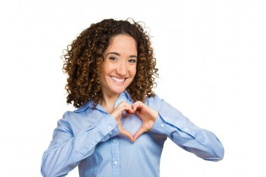 Happy, young woman making heart sign with hands