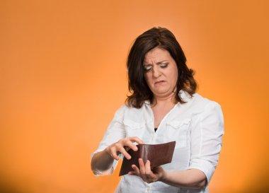 Broke woman showing empty wallet
