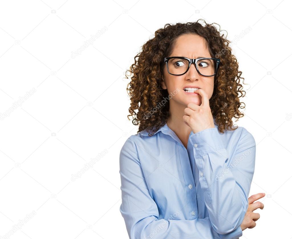 Nervous woman with glasses biting her fingernails