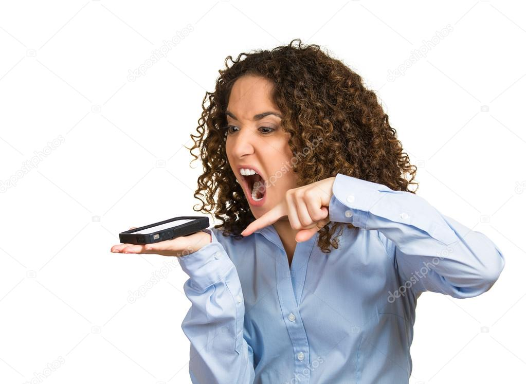 Mad, frustrated angry woman yelling on phone