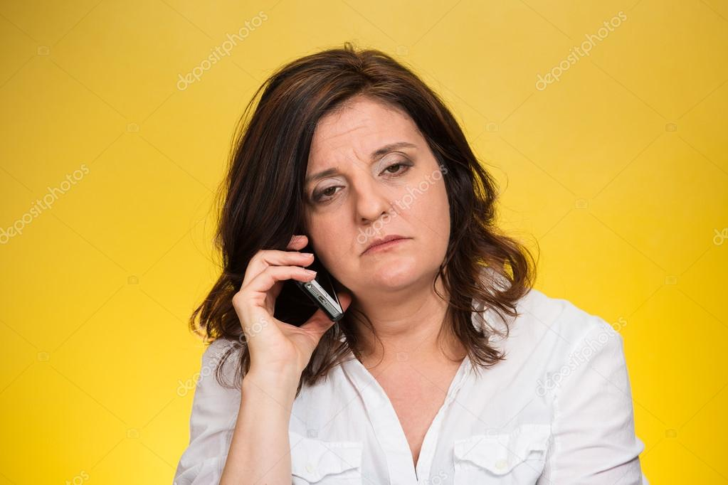 Sad, depressed, unhappy, worried woman talking on phone
