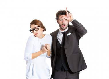 Closeup portrait couple, business people. Bully husband, man standing upfront, angry, giving bully sign with hand, shy, timid wife, nerdy insecure woman with glasses isolated on white background. Human emotions expressions stock vector
