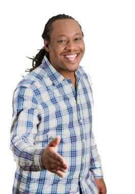 Smiling man giving, extending arm for handshake