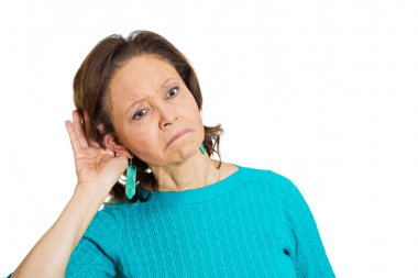 Nosy worried funny senior mature woman, hand to ear, trying to listen eavesdropping