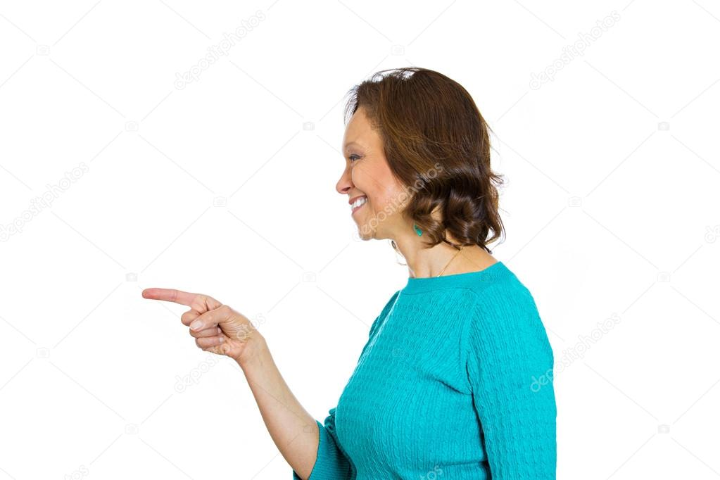 Senior woman pointing with finger laughing