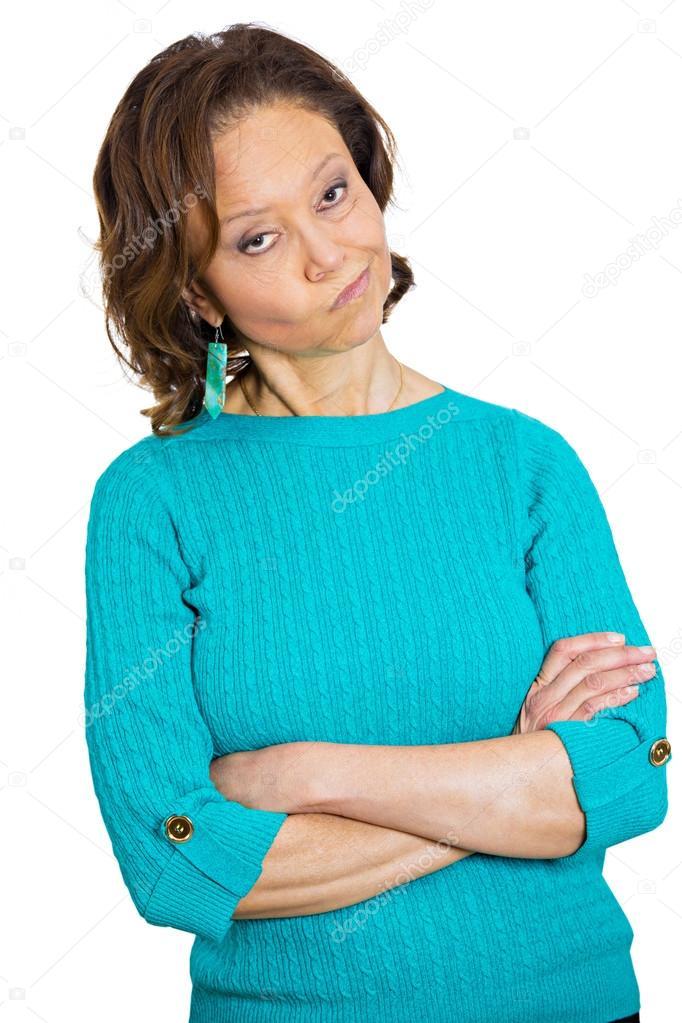 Grumpy, skeptical senior woman