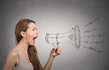 Angry screaming woman holding megaphone