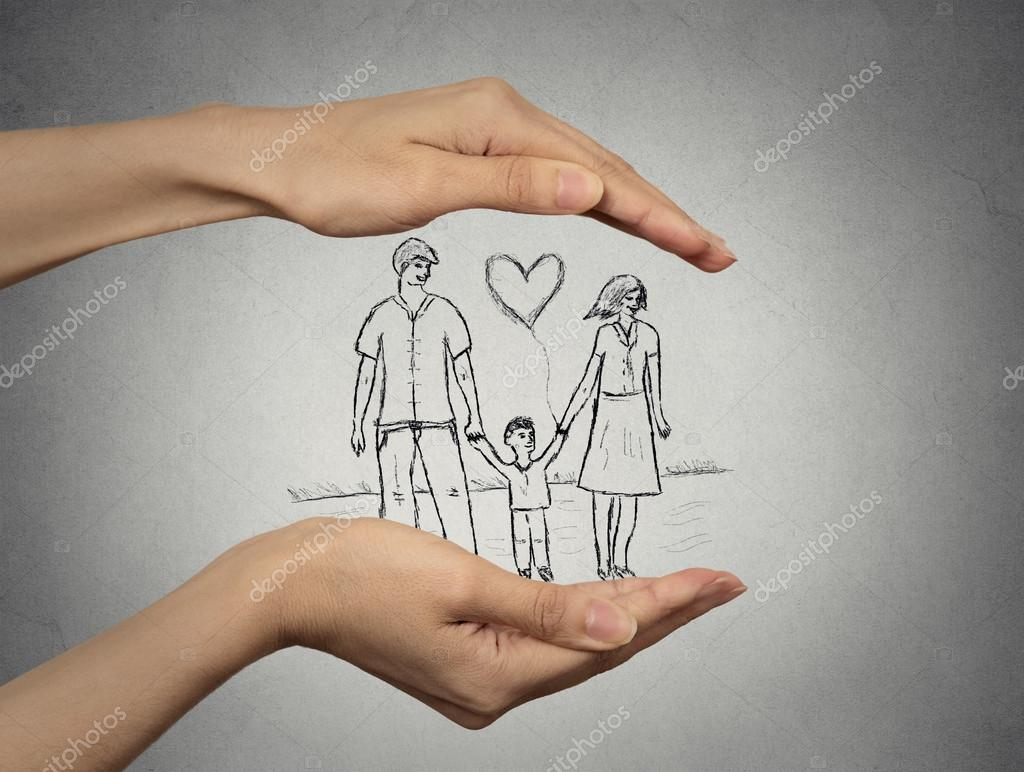 woman's hands protecting happy family