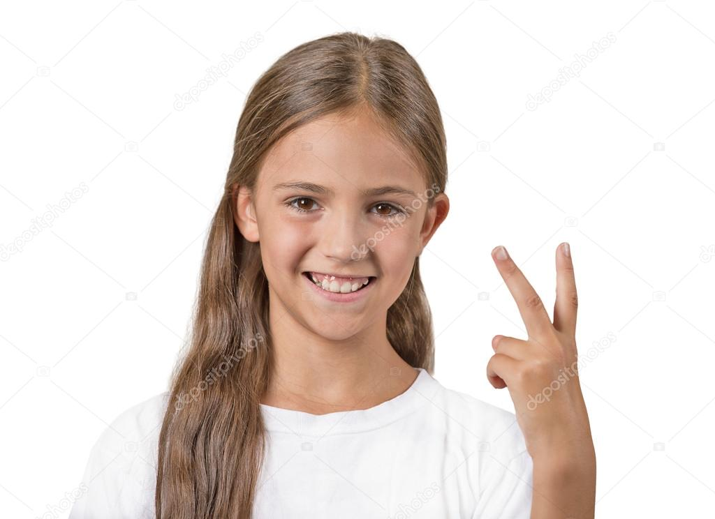 Happy teenager girl giving number two, victory sign