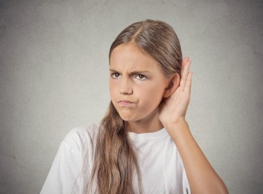 curious teenager girl  hand to ear, listening to gossip