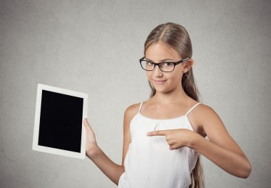 teenager girl shows tablet with touchscreen display