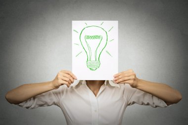 Businesswoman with green light bulb instead of head