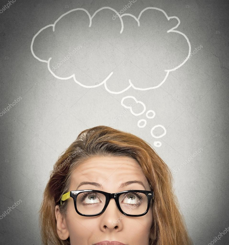 thoughtful woman and blank bubble with copy space above her head