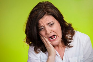 woman with sensitive tooth ache