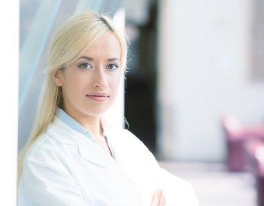 smiling, confident, female doctor