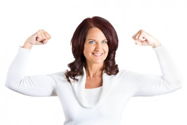 woman flexing muscles showing, displaying her strength