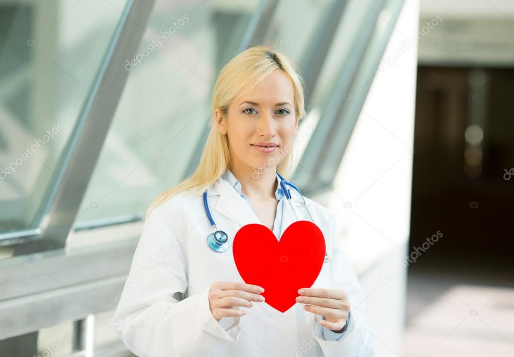 family doctor cardiologist holding red heart