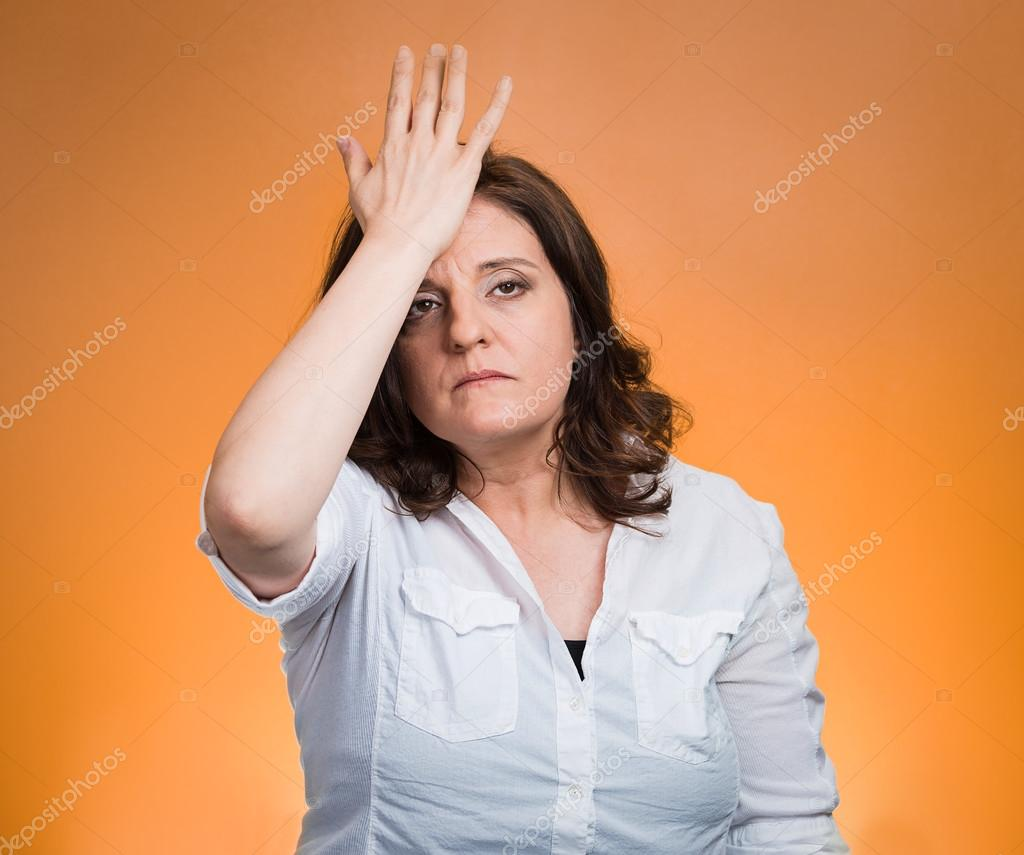 Woman with palm on face gesture in duh moment