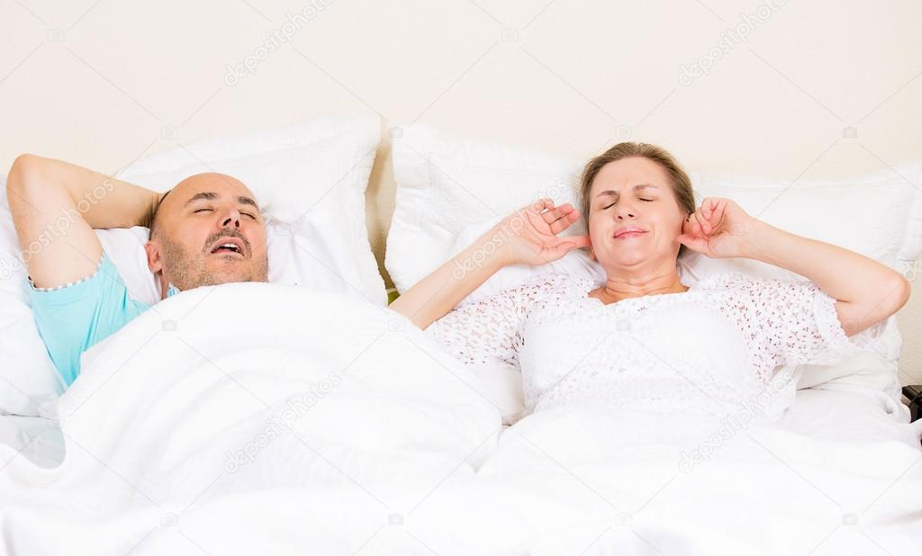 Snoring man, frustrated woman