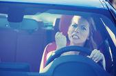 Photo angry aggressive woman driving car