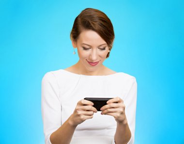 smiling woman texting on smartphone