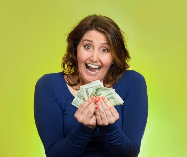 excited business woman holding money