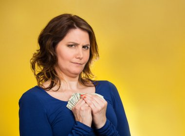 greedy woman holding dollar banknotes