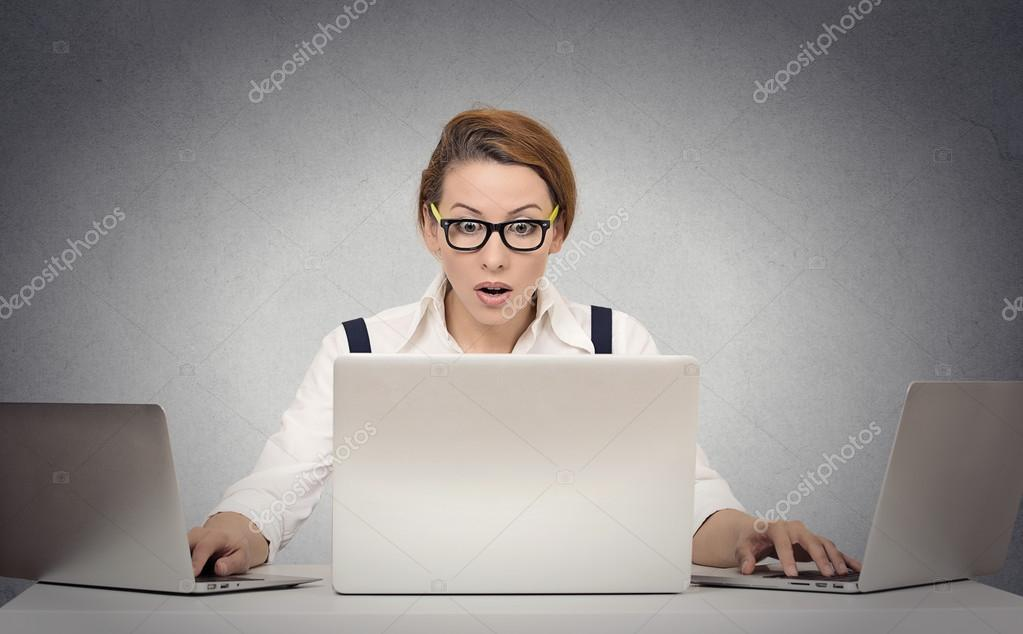 woman multitasking working on several computers