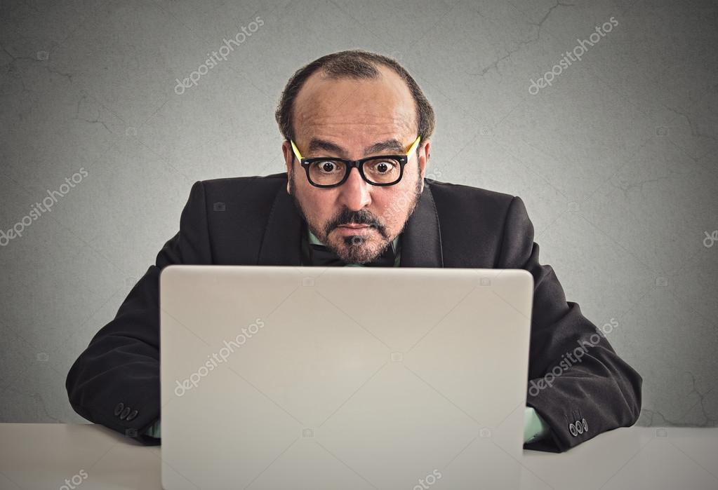 Man looking concentrated on computer screen
