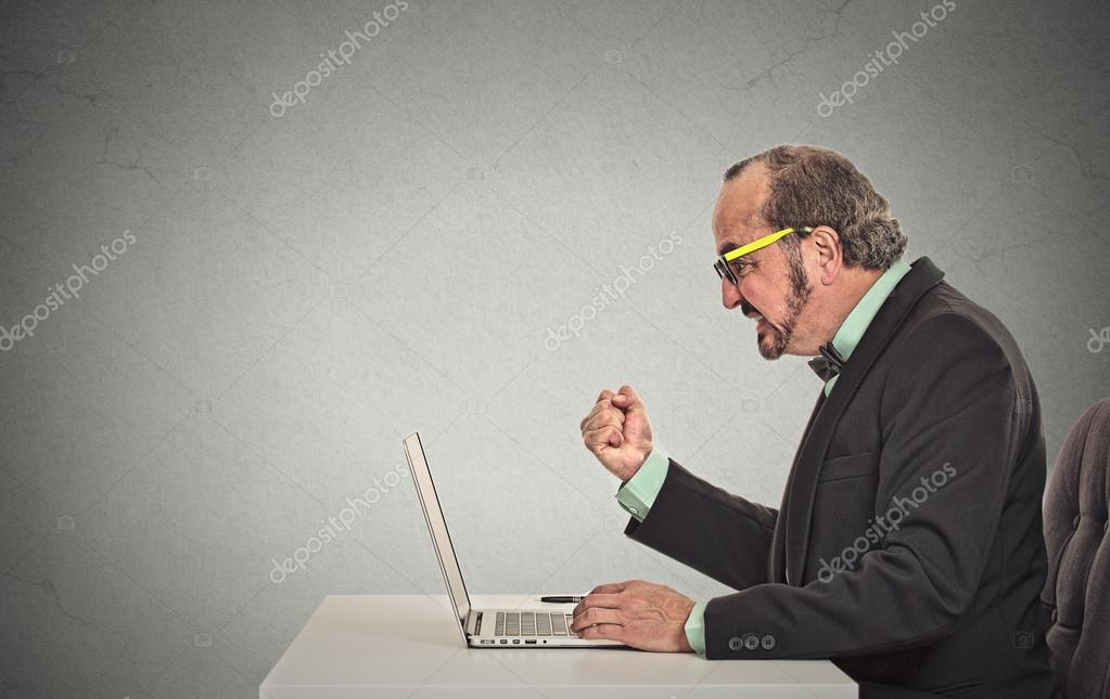 Man angry frustrated at computer
